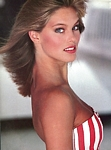 red-white-striped dress - American Photographer 1-1987 = 8/1982 by Jacques Silberstein