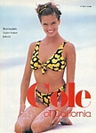 Cole of California sitting on the beach - U.S. Cosmo 12-87